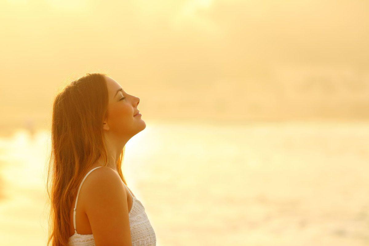 woman breathing fresh air